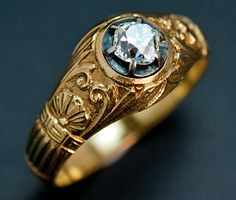 Vintage Russian Gold and Diamond Neo-Classical Style Men's Ring    made in Moscow between 1908 and 1917    The 14K gold ring is decorated with cast scrolls, leaves, shells and the Greek key pattern on a matted ground.