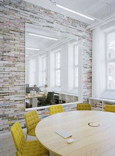 Swedish architects Elding Oscarson, office design for Oktavilla, an advertising agency. The patterned walls are made from stacks of magazines