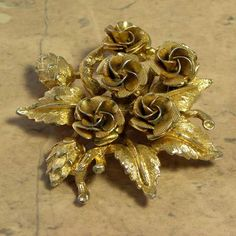 Vintage Golden Rose Bouquet Brooch Corsage This all gold tone and textured rose brooch is arranged in a bouquet of flowers and leaves Traditional pin