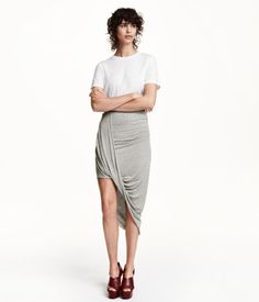 Unique hemlines are all the rage for Fall, as are one-shouldered tops.  This skirt from H&M  is kind of like a one-shouldered top for your bottom half!