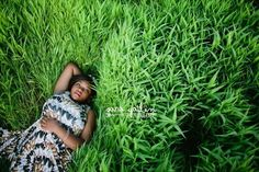 Lie down in the brightest pillow of green grass you can find. | 47 Brilliant Tips To Getting An Amazing Senior Portrait