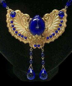 1920's Egyptian revival scarab jewelry.  The Art Deco movement inspired designers of all types.