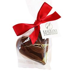 A large chocolate heart to be melted into milk, creating a delicious, luxury hot chocolate drink for two to share. A wonderful Valentine's Day gift, perfect for sharing with your special someone. Each heart is finished with a red satin ribbon tied in a bow. Choose from a rich, classic dark chocolate, or smooth, creamy milk chocolate heart. P.S. The dark chocolate heart is vegan friendly. (Eponine Patisserie & Chocolaterie)