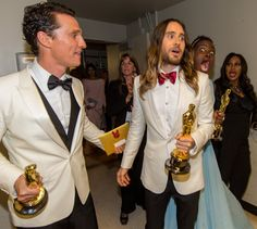 Pin for Later: 24 Celebrity Photobombs That Still Crack Us Up Lupita Nyong'o Lupita got animated behind fellow Oscar winners Jared Leto and Matthew McConaughey backstage at the 2014 award show.