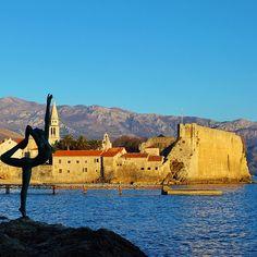 "Beautiful Budva and the ""Dancing Girl"" statue reaching for it all #Budva #Montenegro #travel #wanderlust #aroundtheworld #traveltheworld ✈️"