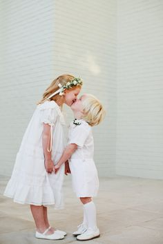 Flower Girl and Ring Bearer Kiss   photography by http://www.kristynhogan.com