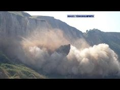 30.000 tons of cliff falling down at beach in France
