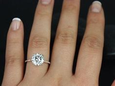 Large diamond with small diamond band.