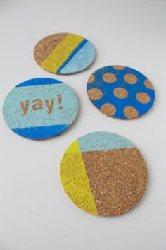 Geometic designs painted on cork coasters -- a DIY