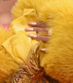 Manicurist Kimmie Kyees used Red Carpet Manicure Gel Polish in My Favorite Designer (a pastel pink) as the base of this gilded manicure. She then added pink and gold holographic glitter on top in an ombré effect.                   Source: Getty