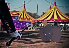Animal cruelty: Dumbo cowers in the background as a circus master holds a whip in a blood-...
