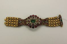 Armlet; gold set with precious stones, rubies, emeralds and diamonds. India, 18th century