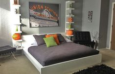 Light gray teen boy's bedroom with orange and gray accent peices. Get the look with Dunn-Edwards Stone Creek DE6278 for your walls.