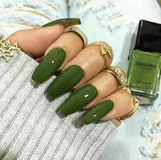 Long coffin shaped acrylic army green nails.