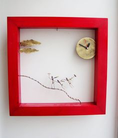 Red wooden frame clock with windblown figures bronze by Akatos, $235.00