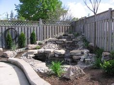 Would be prettier with bigger rocks - I like that it's in a corner of the yard - that's were I'll probably put ours