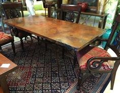 Amazing dining table has hammered copper top on an iron base with delicate splayed, legs. You've never seen anything like it. Seats 6-8. 6' x 3'