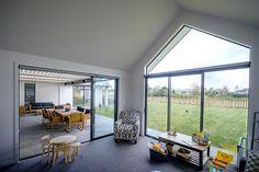Brodie & Niki Retallick's living room, opening out onto the outdoor entertainment area. #house #livingroom #interiordesign #windowdesign #brodieretallick #generationhomes