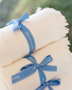Fleece throw blankets rolled and tied with custom ribbon
