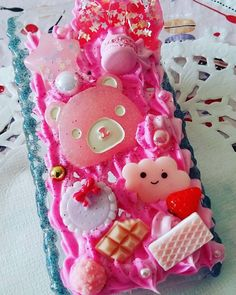 This is a Decoden Phone Case with some cute cabochons with sweets and a cute bear. Its a pink colored hard case. The whip cream is colored in pink too with sides made with deco sauce in blue color. I hope you like it! Iphone 5 Case ------------------------ If you like to have your own custom made phone case then please dont hesitate to drop me a message. I will try to answer as soon as I can! You can also visit me over: https://www.facebook.com/philiadecorart or my Homep...