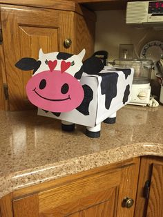 Cow Valentine's Day box for kids. Toilet paper rolls as legs and neck
