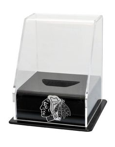 """NHL Chicago Blackhawks Single Hockey Puck Display Case with Angled Base by Caseworks. $39.95. He shoots... he scores!! Display your favorite hockey puck in this Collectors Deluxe Single Puck Case with angled, acrylic base and lid for maximum view. Includes your favorite NHL team logo or the NHL League logo. Measures 4 3/4""""W X 4 3/4""""D X 6 1/4""""H. Puck not included. Made in the USA."""