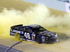 Jimmie Johnson celebrates with a burnout after clinching his sixth Sprint Cup championship.  11/17/2013