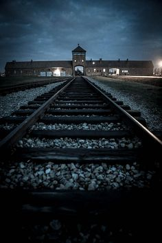 the main gate of the auschwitz birkenau camp .. even more terrifying at night ...