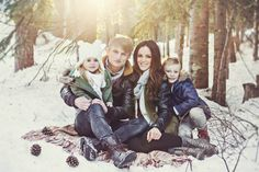 Winter family photos, mother, mommy, daughter, girl, father, daddy, son, boy, hugs, snow, blanket, pine cones, hat, scarf, trees, sun, Christmas, holiday.