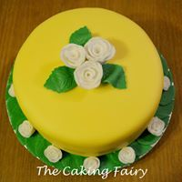 Yellow cake with white roses by The Caking Fairy. Celebration Cakes, White Roses, Fairy, Yellow, Desserts, Food, Shower Cakes, Tailgate Desserts, Deserts