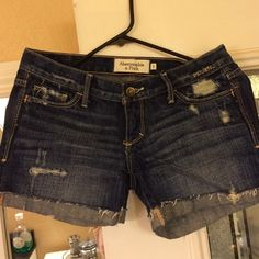 Abercrombie & Fitch distressed denim shorts Denim shorts with distressed fabric. Shorts fold up on the bottom but can be rolled down. Great used condition. Abercrombie & Fitch Jeans