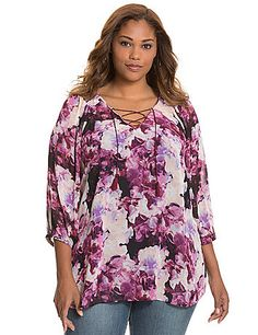 pretty 3/4 sleeve peasant blouse. In a charming print with a tasseled tie-neck detail and smocked shoulders, this semi-sheer woven top is a favorite for any season. lanebryant.com  -  floral blouse, shirt, top.     lj