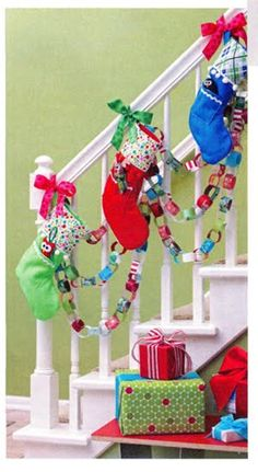decorating idea, use ribbon to hang stockings on staircase