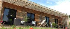 maison ossature bois, maison bois contemporaine, toit plat, maison bbc ossature bois, bardage bois, terrasse bois, maison bioclimatique
