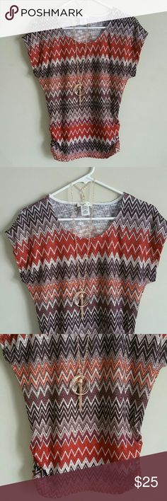 Beautiful Tops With Necklace. New never worn. Brand new top with necklace.new never worn.  Size Small ,missing tag. Length 26 in Bust  35 in 90% Polyester  10% Spandex. Smoke and pet free home. Tops Blouses