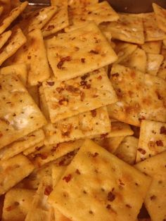 Ingredients       	1 1/2 sticks butter, melted   	1 packet ranch dressing mix   	2 T. red pepper flakes   	1/2 tsp. garlic powder   	2 sleeves saltine crackers   	parmesan cheese      Steps    In a large bowl combine melted butter, dressing mix, pepper