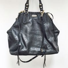 Rebecca Minkoff | ostrich Romeo tote color: Black Ostrich embossed leather with goldtone hardware Snap flap pocket and two side zip pockets at front Magnetic top closure with side zip adjustments and tassel pulls 13'' rounded top handles with studs and 5'' drop Fabric lined Side zip pocket and two organizational pockets Measures approximately 14'' at widest x 13'' tall at center x 5'' deep; weighs 3 lbs. Leather; Imported; style# 321463601  NO TRADES  Used but in good condition Rebecca…