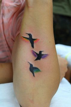 Mabye one hummingbird for each of my sisters, and their favorite colors on the wings