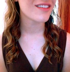 No heat curls! Here's how you can do it:  1.) Brush wet hair the way you usually style it.  2.) Section hair (I used two sections) into how many sections you'd like.  3.) Twist hair around fingers a billion times. The more times you twist, the curlier it will be.  4.) Use hair spray to hold hair into place. Other oils and curling creams may help.  5.) When completely dry, brush sections with your fingers.  And voilà! Your hair is all curly and cute. I hope this helps! :)