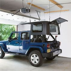 Keep your garage clutter free with a Harken Hoister Hard Top Storage System. This practical and easy to use kit allows you to store your Jeep Hardtop up near the ceiling of your garage utilizing a system of hooks and pulleys. Wrangler Jeep, Jeep Wrangler Unlimited, Jeep Rubicon, Jeep Wranglers, Jeep Wrangler Accessories, Jeep Accessories, Jeep Hardtop Storage, Jeep Hard Top, Jeep Tops
