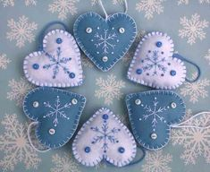 Felt Christmas heart ornaments, Handmade blue and white snowflake hearts, Scandinavian embroidered heart decorations, felt tree ornaments Felt Christmas heart ornamentsHandmade blue and by PuffinPatchwork Felt Christmas Decorations, Felt Christmas Ornaments, Handmade Ornaments, Handmade Christmas, Christmas Diy, Snowflake Ornaments, Handmade Bookmarks, White Christmas, Tree Decorations