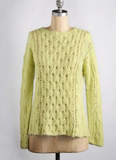 Artful lace stitches meander across this pullover. Softened in appearance by the brushed quality, but warm and breathable, this dreamy sweater will be a welcome layering addition to your wardrobe. Pattern No. CP