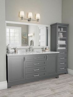The contemporary School House Slate finish and quality craftsmanship of the Lynn 60 in. vanity is a classic in any bathroom. Inspired by authentic all-American style, this premium entry in the Martha Stewart Living bath collection features a luxurious Carrara marble countertop with double bevel edge and chrome hardware. Two paneled doors plus drawers hide bamboo pull-out trays with dividers and adjustable shelves to keep necessities close at hand, plus a c
