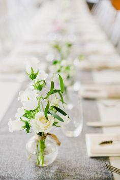 Modern white rose wedding table jars: http://www.stylemepretty.com/california-weddings/san-francisco/2016/10/03/modern-san-fran-restaurant-wedding/ Photography: Onelove - http://www.onelove-photo.com/