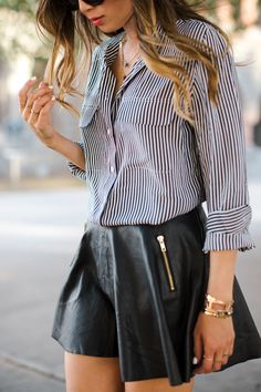 We love how Aimee Song of Song of Style has paired the exclusive Equipment striped shirt with a leather skirt! #THEOUTNET5 #Equipment