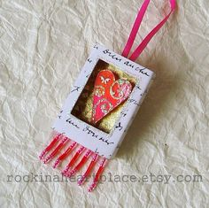 Matchbox Art  Heart in orange and pink by RockInAHeartPlace, $9.75 A cute way to combine gellie prints and beads and polymer clay tiles.