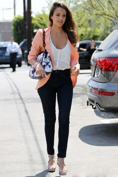 Peach blazer with a semi sheer white top, skinnies and heels