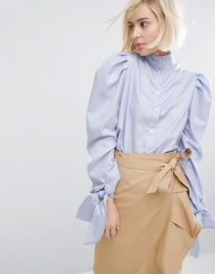 Pretty light blue shirt with knotted sleeves