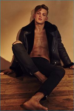 Sebastian Sauvé rocks a shearling coat and ripped denim jeans from BLK DNM.