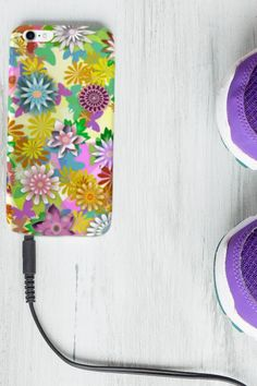 The phone is the one possession that is probably visible all day long -in your hand as you walk, on your desk at work, or sometimes, even on the table when dining. In terms of accessories, we can't think of one that people interact with more than the phone case. So why not choosing our flowery mandalas case for your iPhone or Samsung? #phonecases #phonecover #flowercover #flowerscase #iphone #samsung #cellphone Phone Covers, Samsung, Desk, Dining, Iphone, Floral, Flowers, Table, People